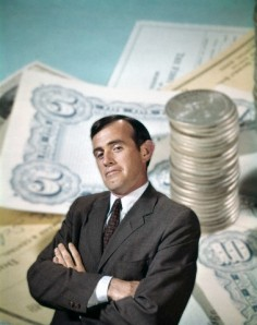 1960s BUSINESSMAN FACIAL EXPRESSION BACKGROUND MONEY CHECKS COINS FINANCE BANKING BUSINESS RETRO