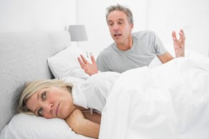 Man arguing with his partner in bed