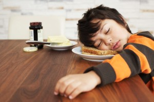 Little boy asleep on his bread