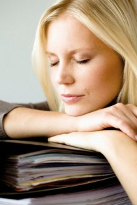 Germany, North Rhine Westphalia, Cologne, Young woman leaning on folder with eyes closed, close up