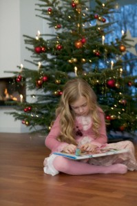Girl with Advent Calendar at Christmas Tree
