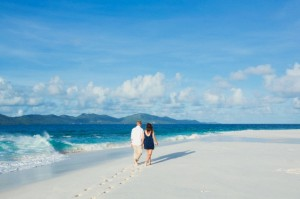 Romantic couple walking on beach.Cousine Island.Seychelles(Model and Property released).