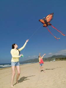 Mother and daughter flying kite