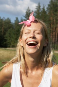 Laughing Woman with Pink Butterfly on Forehead