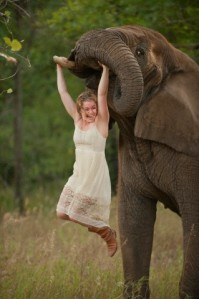 Woman plays with Elephant