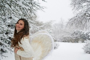 Girl with angel wing in a snowy landscape