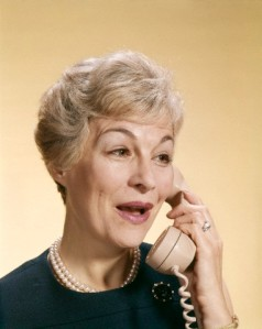01 Jan 1968 --- 1960s SMILING HAPPY SENIOR WOMAN TALKING ON TELEPHONE --- Image by © H. ARMSTRONG ROBERTS/Corbis