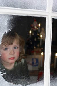 Girl Waiting for Santa --- Image by © Meeke/Corbis