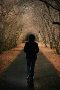 Woman Walks Down a Pathway --- Image by © Patrick Kociniak/Design Pics/Corbis